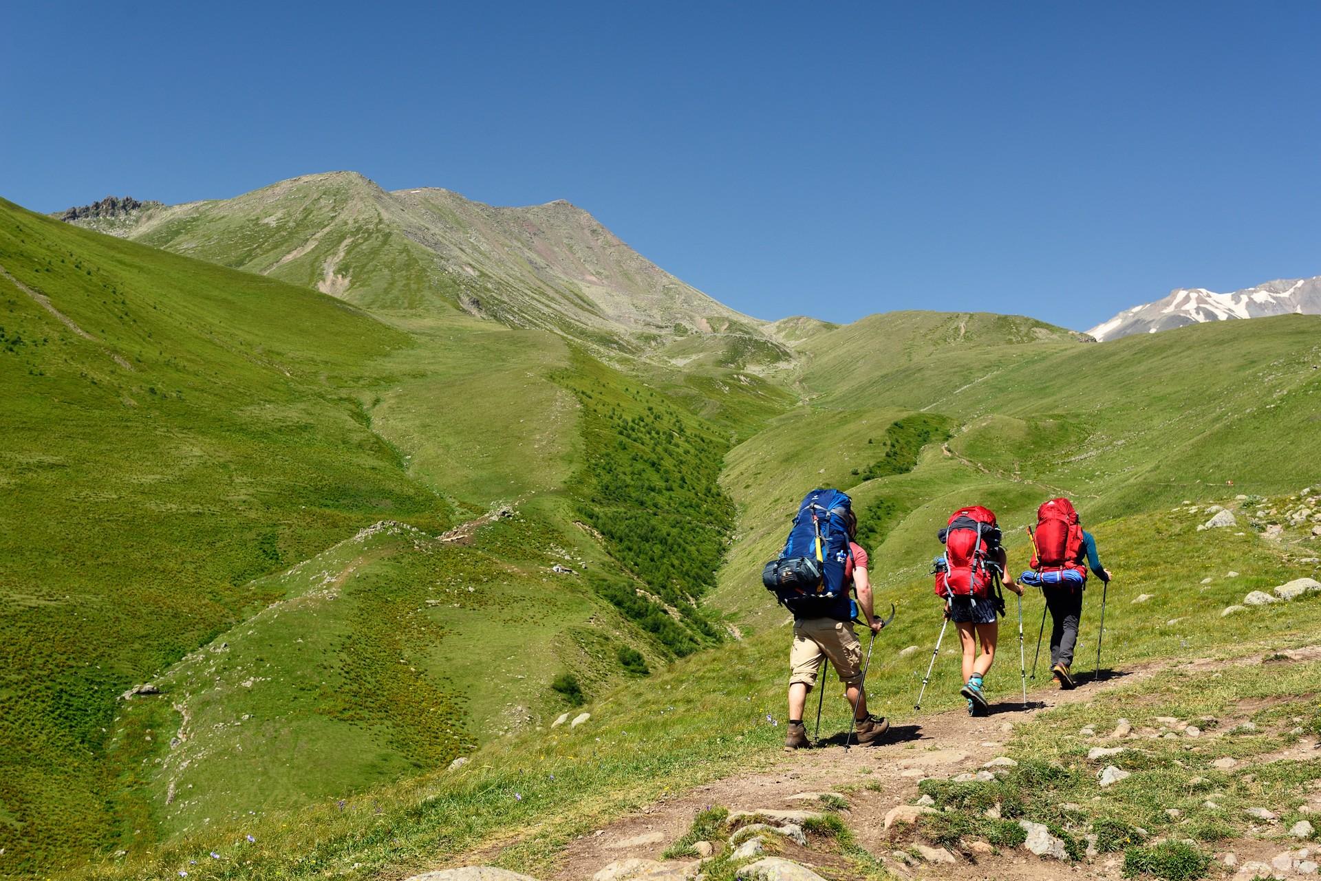 Hikers walking through the Kazbegi region of Georgia