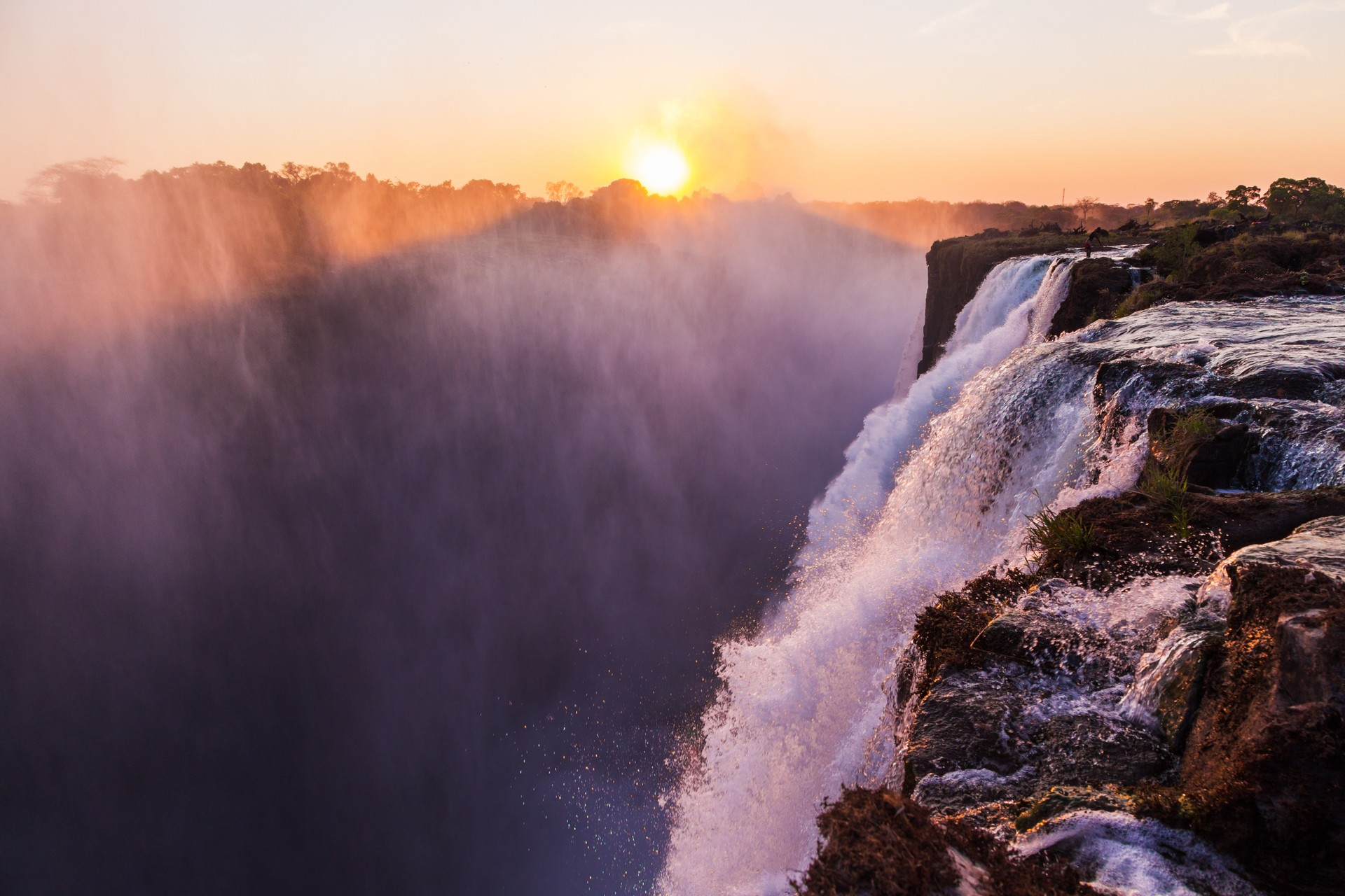 Best things to do in Zambia: Victoria Falls at sunset