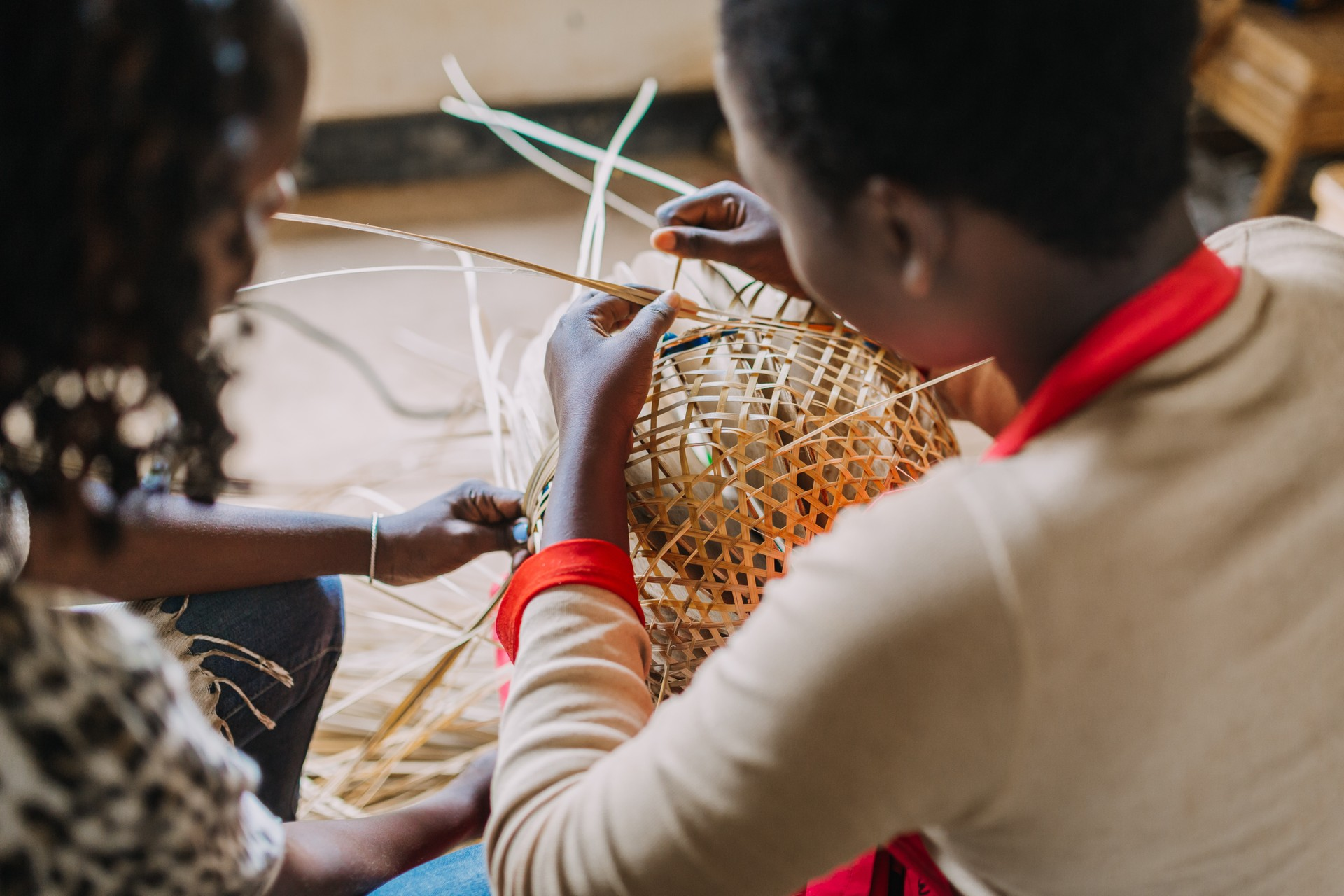 Rwandan women weaving a basket