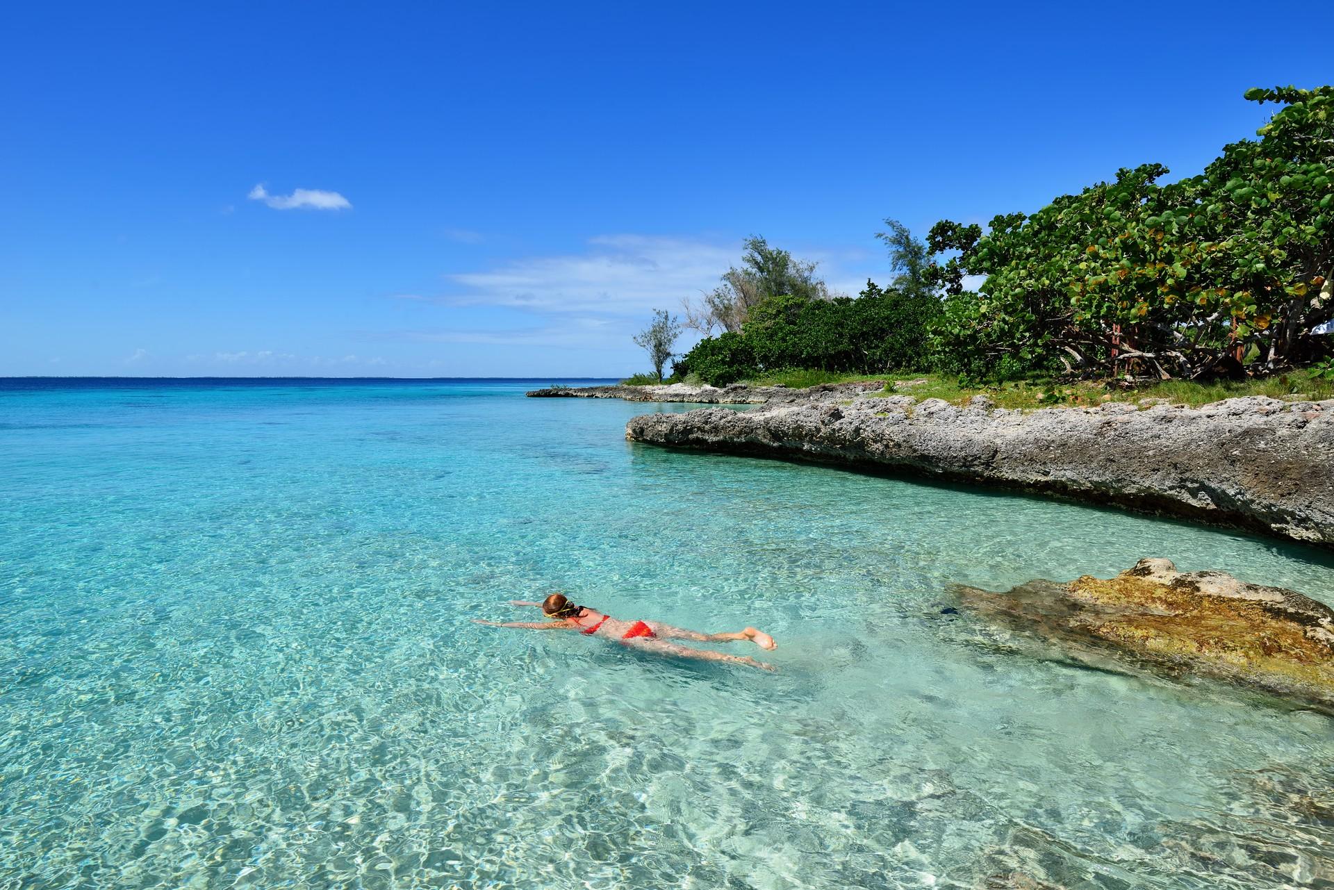 A girl snorkeling on a beach in Cuba
