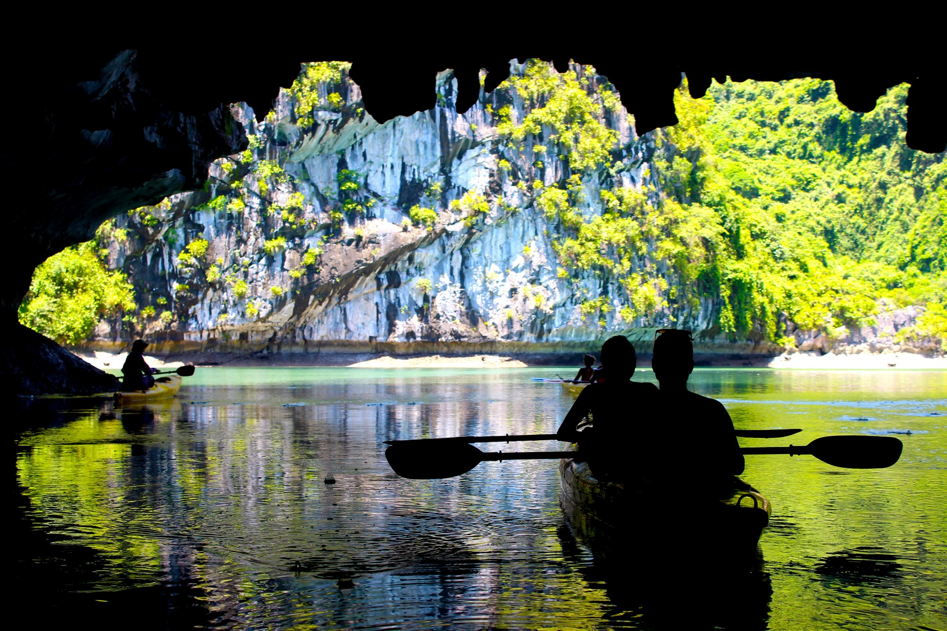 Kayakers in a cave in Lan Ha Bay