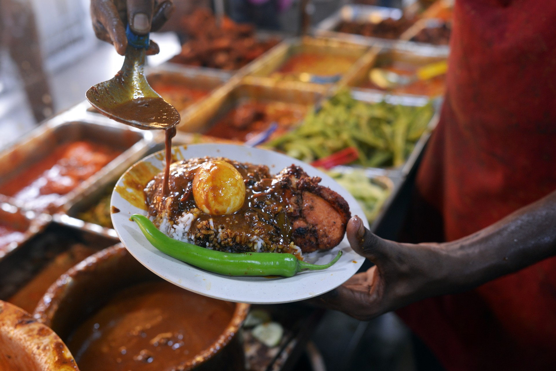 Nasi kandar at a street food stall in Malaysia