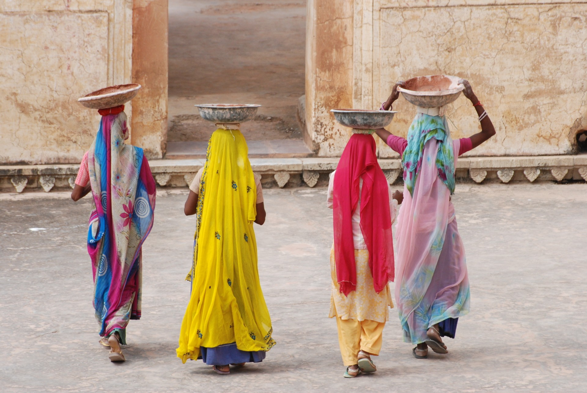 Women carrying baskets in Rajasthan, India