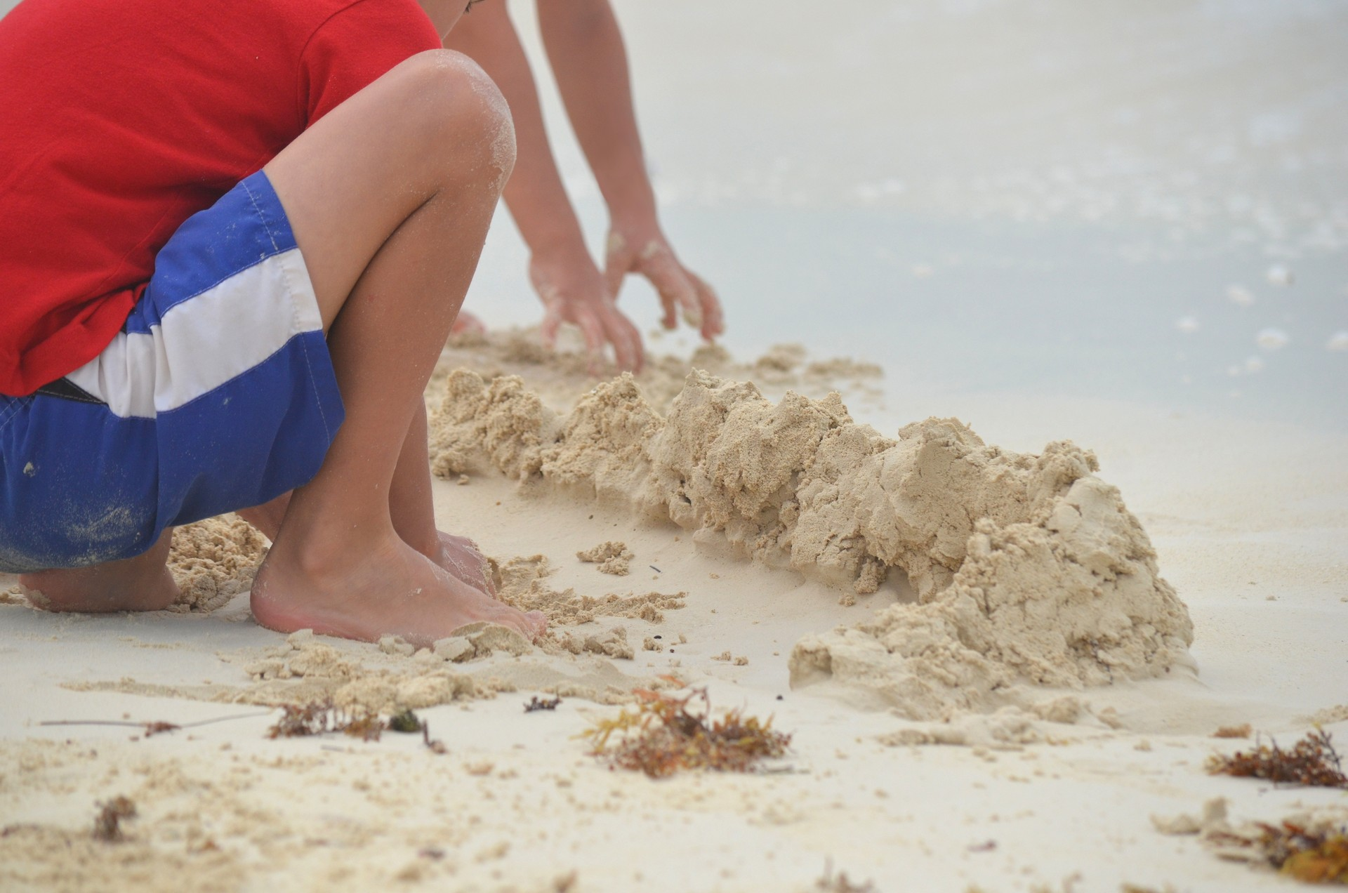 Two boys playing on the beach in Cuba