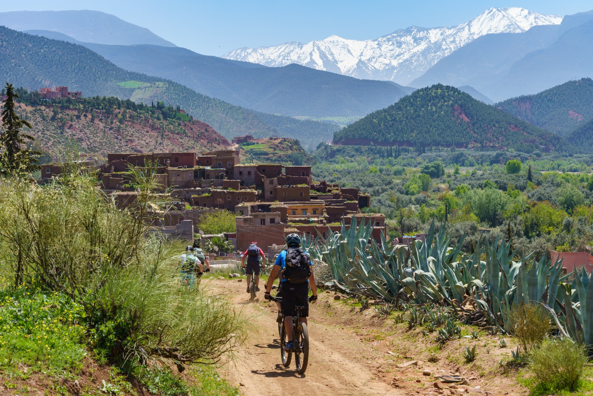 People mountain biking in the High Atlas Mountains