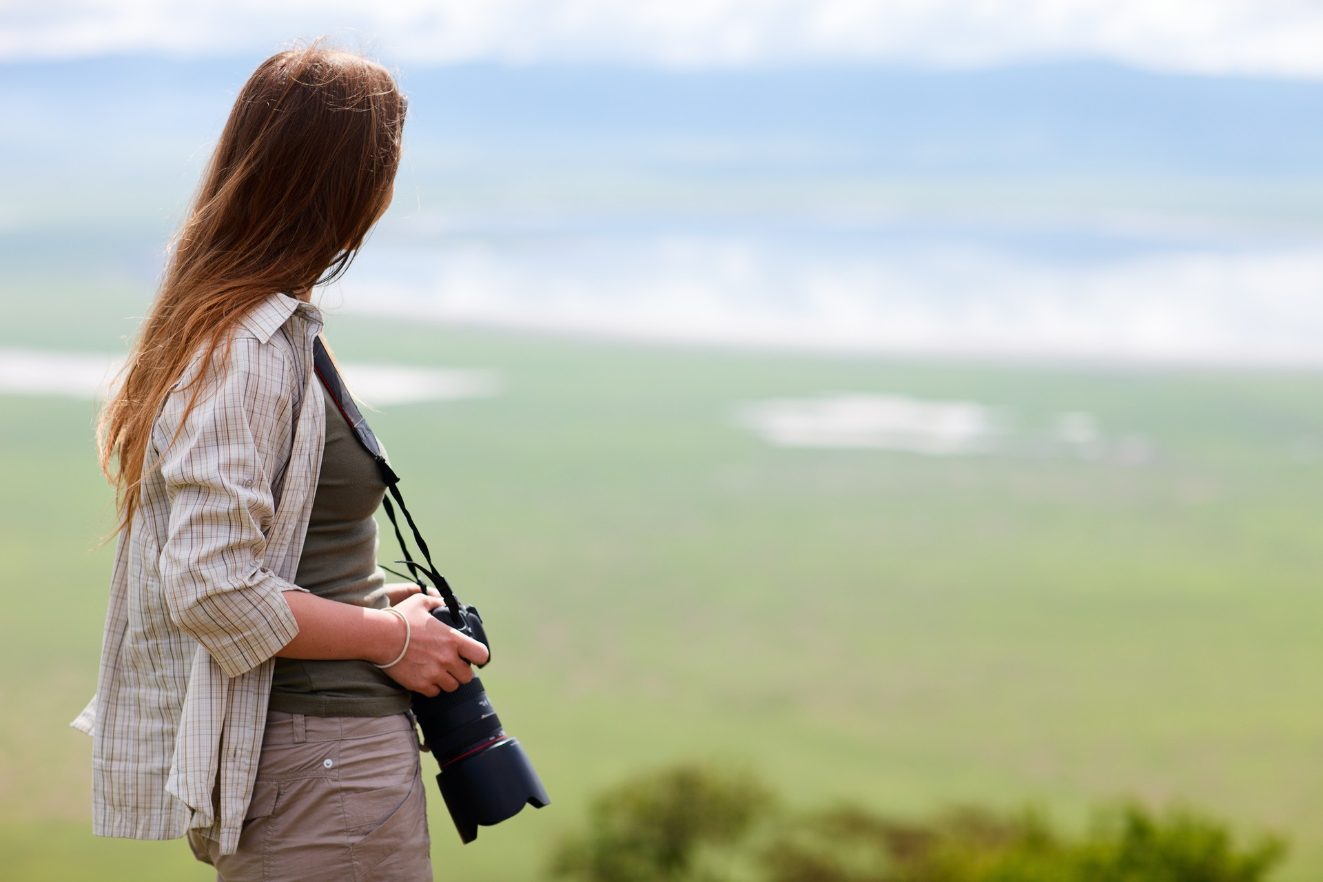 A woman enjoys the view of Ngorongoro crater in Tanzania