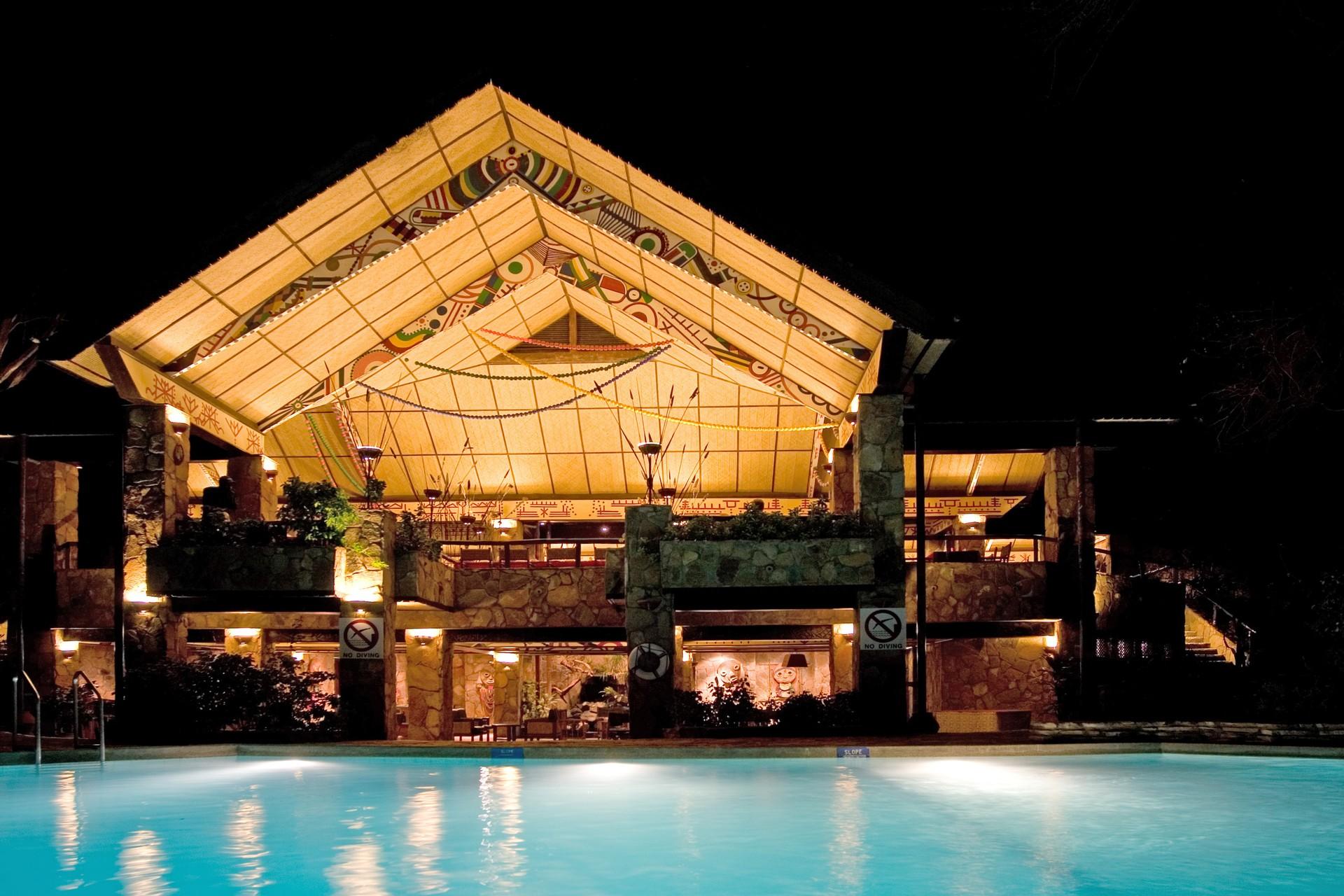 Night view of Kenyan safari lodge with pool