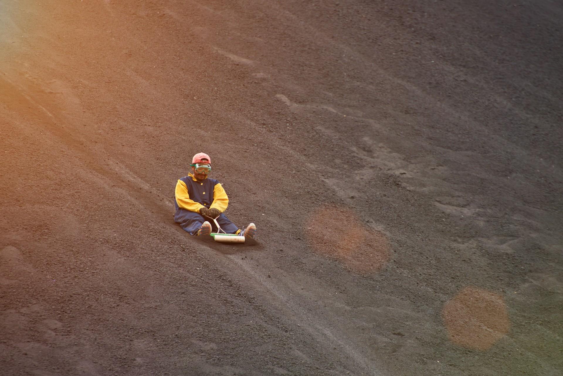 A man volcano boarding in Nicaragua