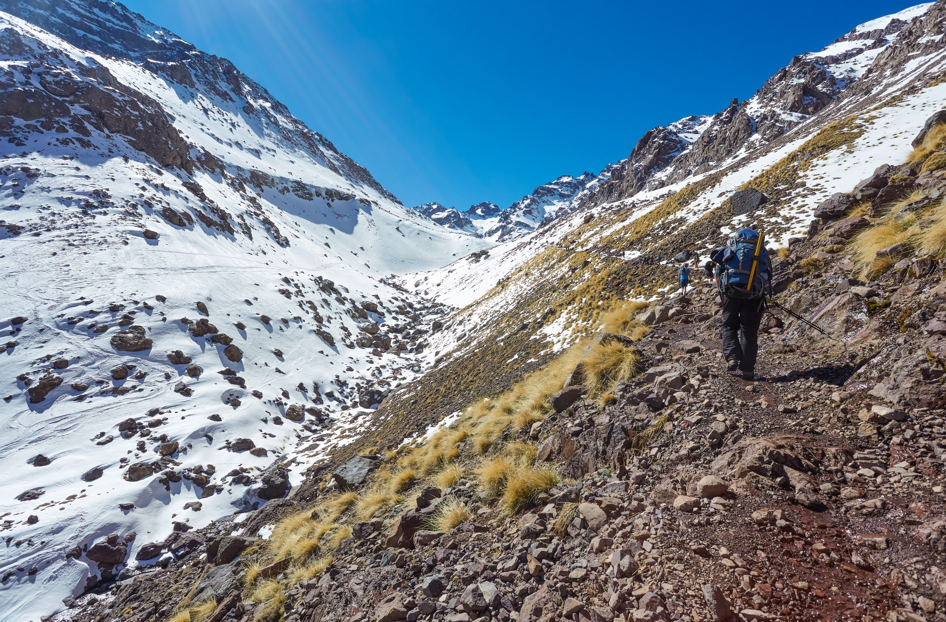 A hiker on their way to the summit of Mount Toubkal in Morocco's High Atlas