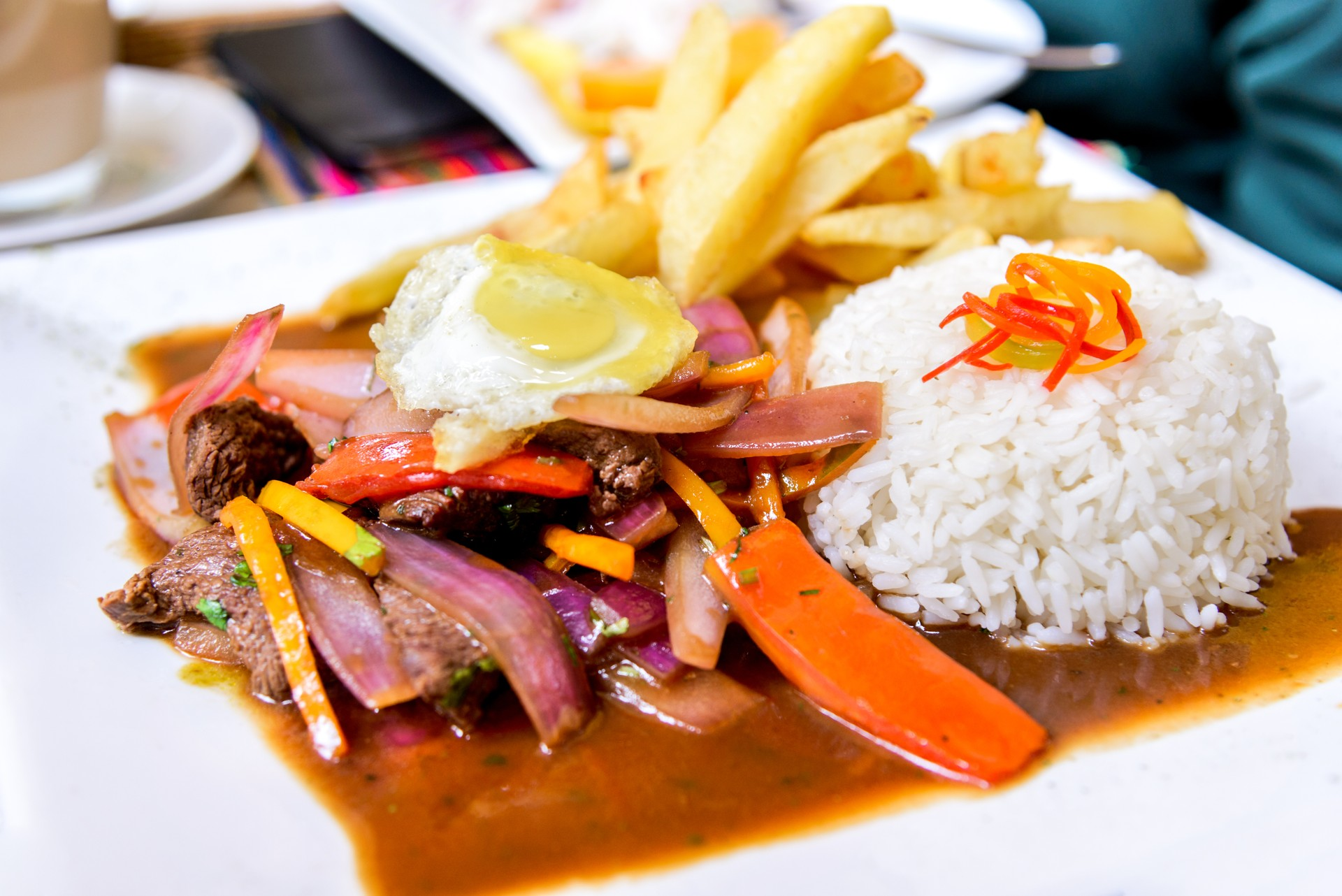 A plate of lomo saltado which is a typical dish of Chifa cuisine in Peru