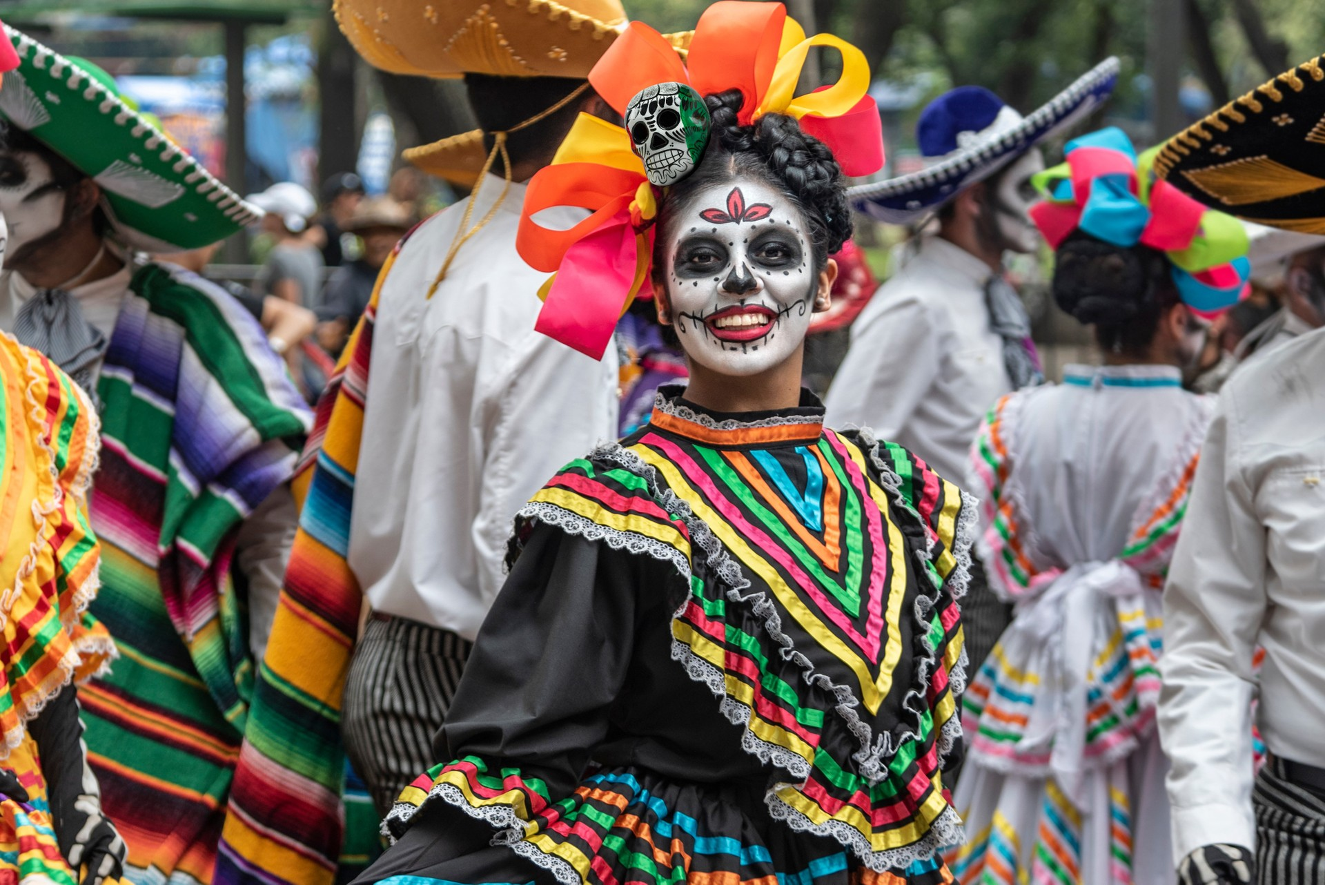 How to experience Mexico's famous Day of the Dead: Woman enjoying the festivities