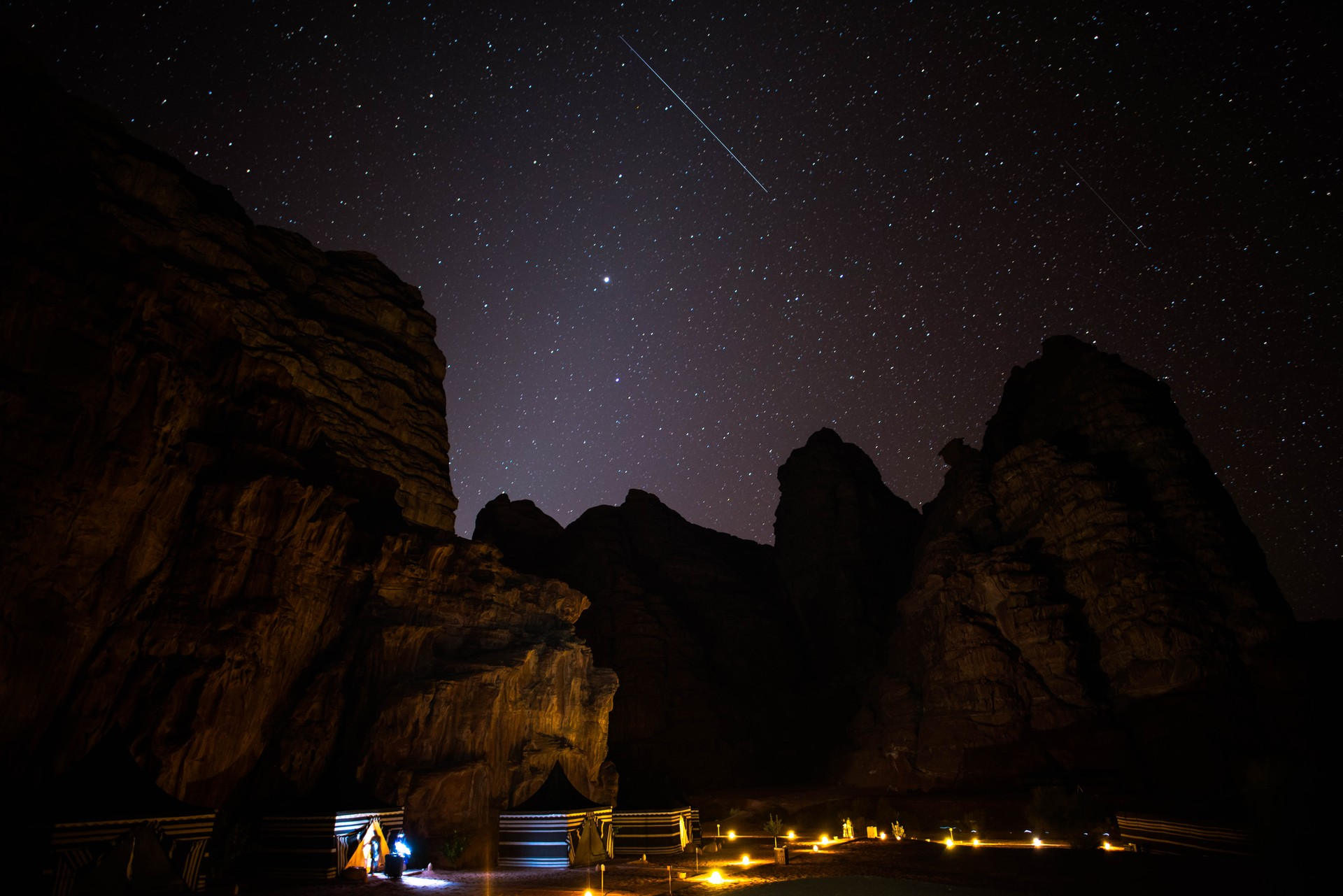 The night sky above a Bedouin camp in the middle of Wadi Rum, Jordan