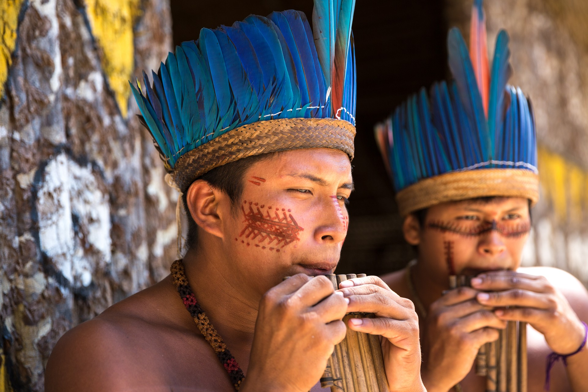 Two indigenous men in the Amazon rainforest, Brazil