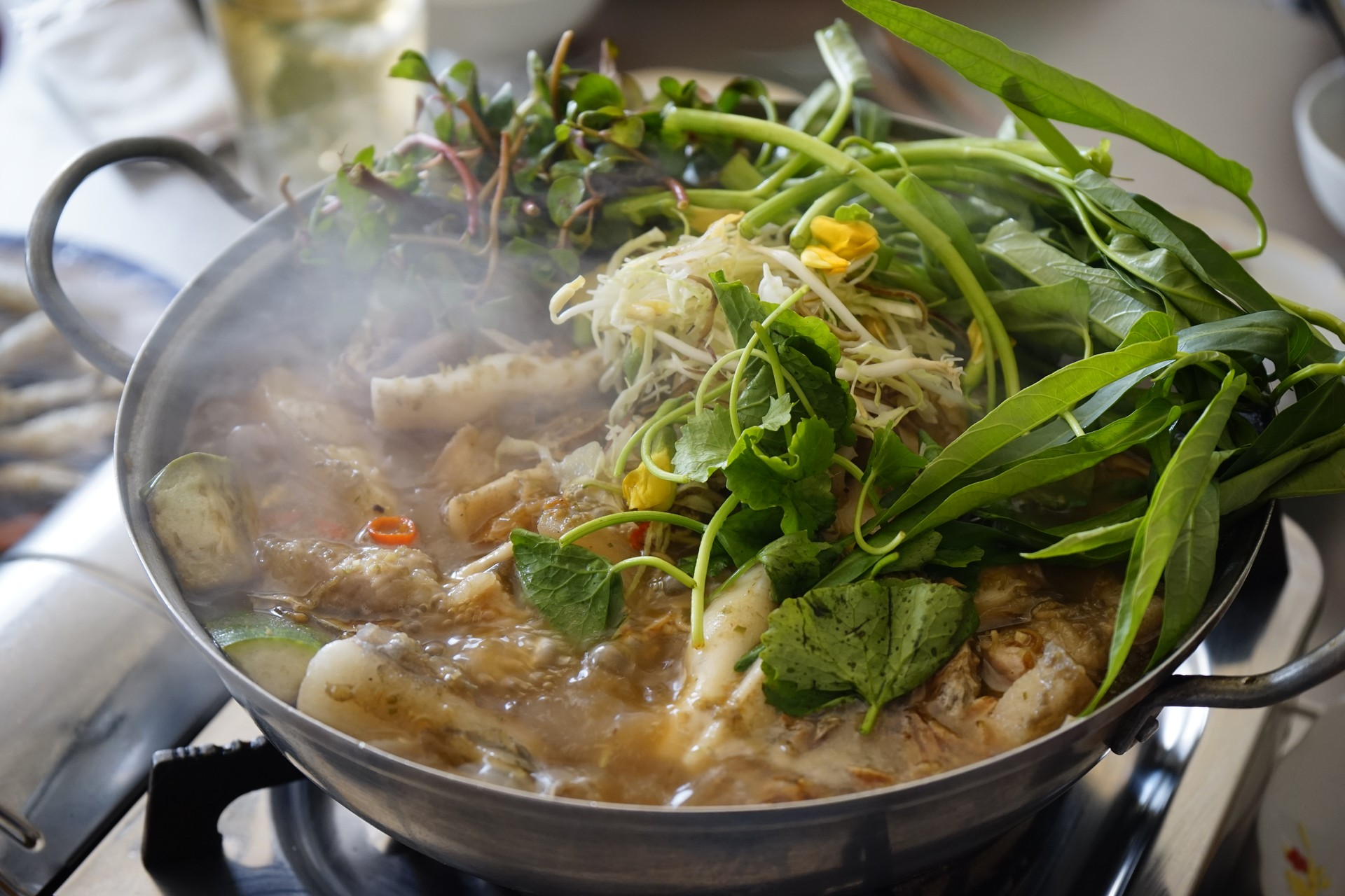 Lau mam - a fish hotpot cooked in Mekong Delta, Vietnam