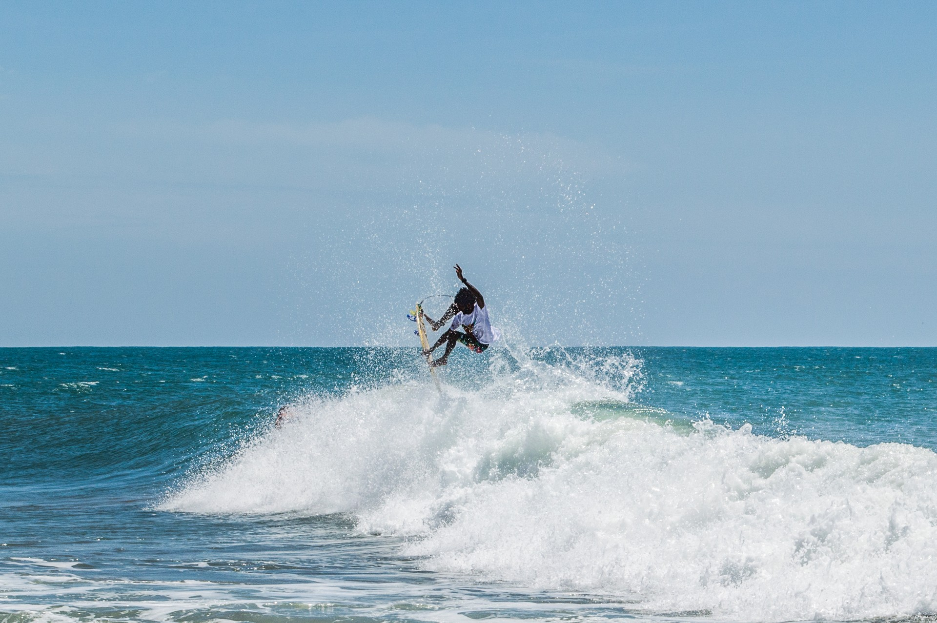 A surfer in Arugam Bay, Sri Lanka
