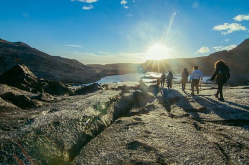 Hikers by a glacier in Iceland
