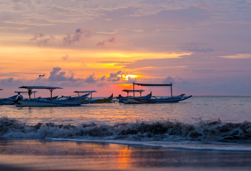 Sunrise over fishing boats in Bali Indonesia