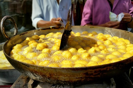 Street food cooking in Delhi, India