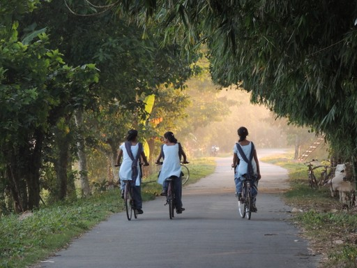 Local girls cycling through India's countryside