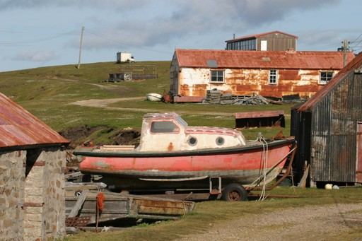 Boat and settlement on the Falkland Islands
