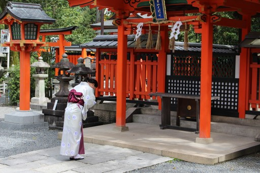 Lady praying at Japanese shrine