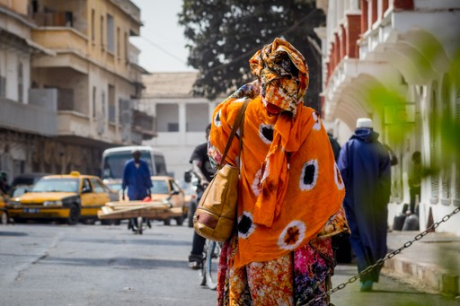 Traditional African clothing on a woman in Saint Louis, Senegal