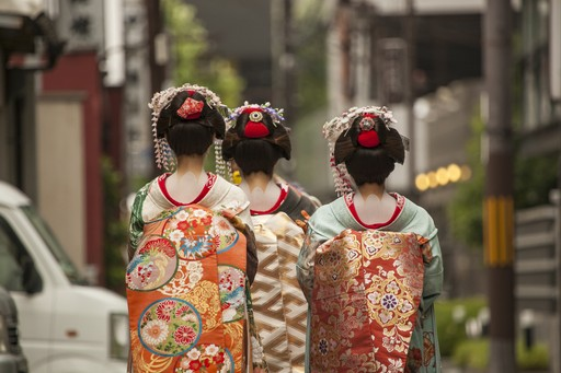 Geisha walking down a Kyoto street