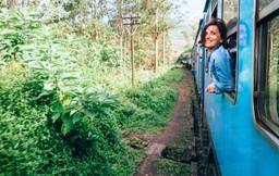 Lady on the train through the tea plantations