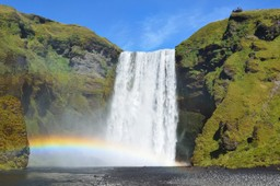A rainbow at the foot of Skógafoss waterfall