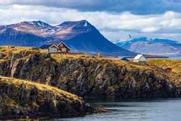 Typical Icelandic house on a rugged shore