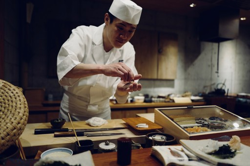Chef serving food in Japan