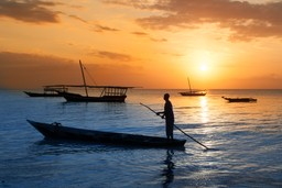 Boatman in Tanzania at sunset