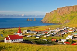 Icelandic village in the sun by the sea