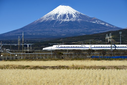 High speed train passing beneath Mount Fuji, Japan