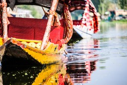 Traditional boat on Dal Lake, India