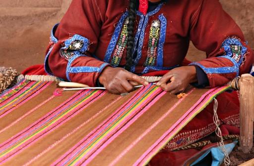 A woman weaving in Peru