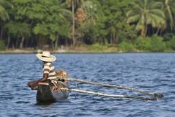 Traditional fisherman in canoe