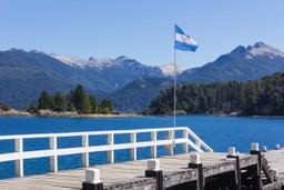 A flag flies above a jetty at Bariloche