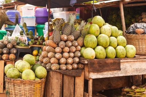 Accra Ghana fruit market stall fresh coconut