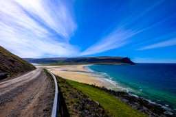 A coastal road to a white sand beach in Iceland