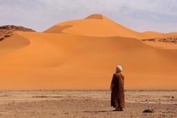 Man in desert, Morocco