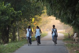 Local girls cycle through Indian countryside